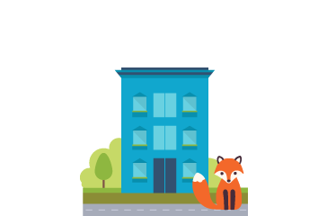 Foxy in front of a small blue office building